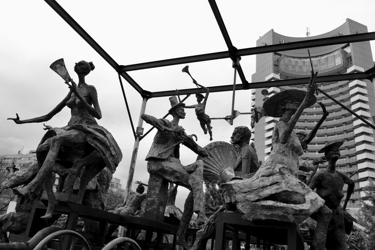 Charming Bucharest: Statues in front of the National Theatre (TNB)