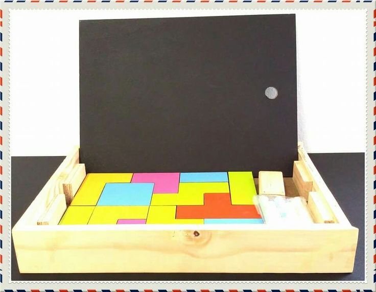 Fun box wooden blocks, black board, duster and chalk.