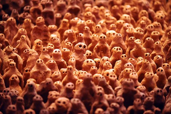 Antony Gormley, little people made up from clay, and placed in a giant room, all looking in the same direction.