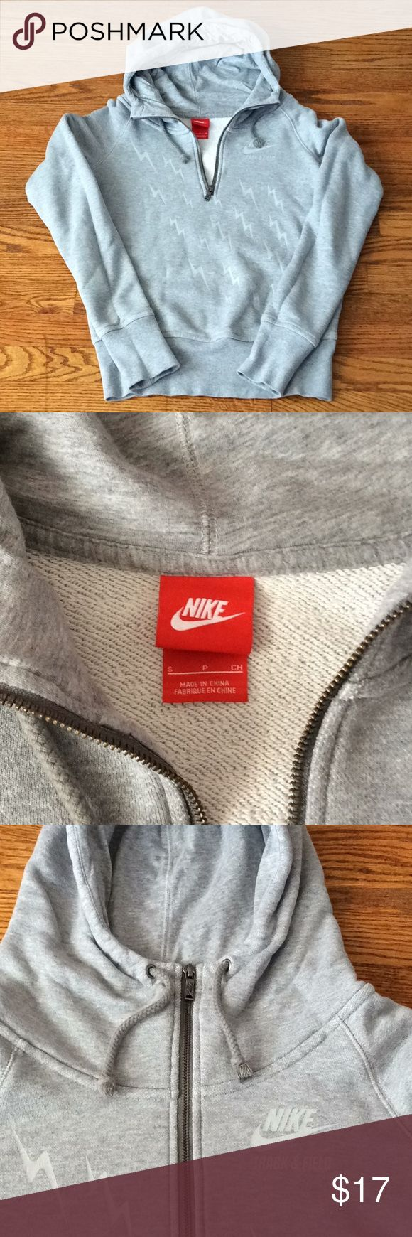 "NIKE 1/4 Zip Hoodie Solid heather gray hoodie, jersey lined hood, ⚡️⚡️⚡️⚡️ graphics, Nike swoosh with track and field and wide cuffs at wrist and hem. Awesome hoodie for any Nike lover. P-P 20"" S-H 25"" Pit to cuff 22 1/2"" Nike Tops Sweatshirts & Hoodies"