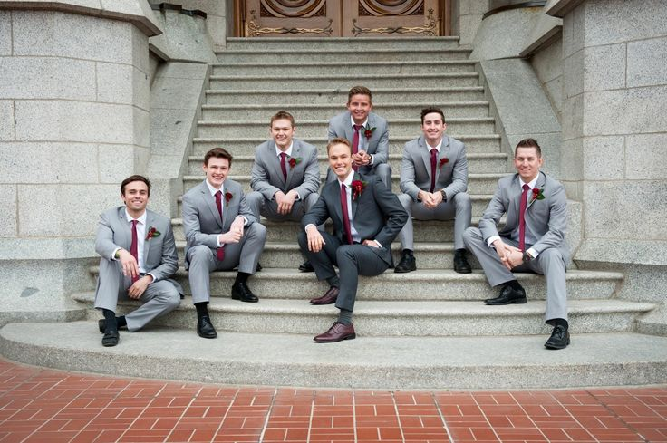 Groom charcoal grey suit, groomsmen light grey suit. Dark and light grey groom / groomsmen
