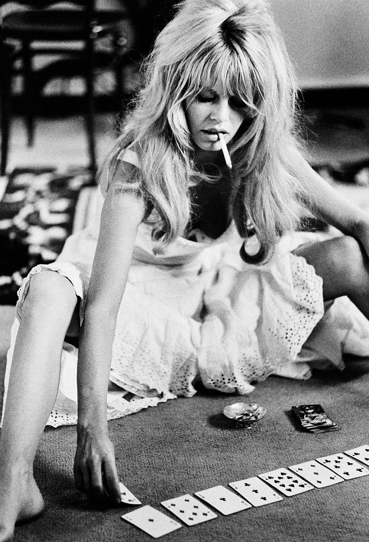 French actress Brigitte Bardot plays cards on set of the comedy-adventure film 'Viva Maria', 1965.    wmag.com
