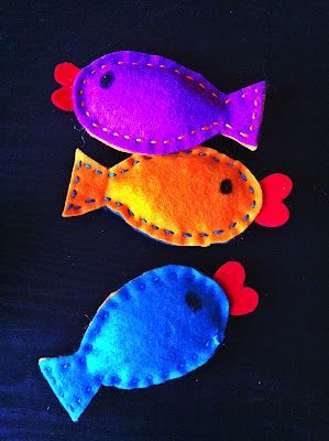 Handmade cat toys - could put thread through a straw and attach one of the fishes on it as a fishing rod :)