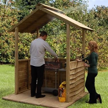 Barbecue shelter with roof filter to let the smoke out