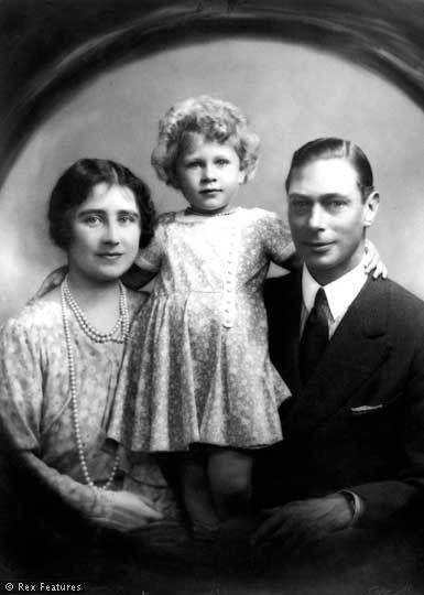 I LOVE how she has her arm around them and all the affection there is in this picture Queen Elizabeth the Queen Mother, Princess Elizabeth and King George VI