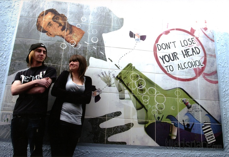 Newcastle-under-Lyme College students collaborate to produce this tiled subway mural with a strong community message.