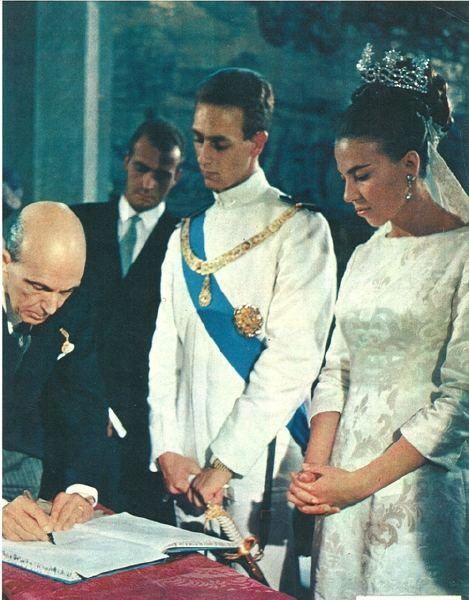 Claude of Orléans, getting married to Amadeo, Duke of Aosta.  They got married in Portugal so the (deposed) King of Italy could attend.