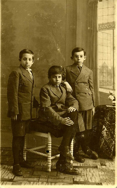 Three brothers , photographed in the photostore of S. van der Plaat in Middelharnis , Holland around the year 1931
