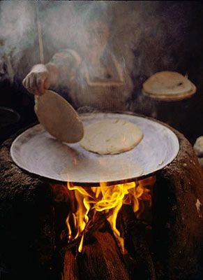 Using a comal to make tortillas → For more, please visit me at: www.facebook.com/jolly.ollie.77