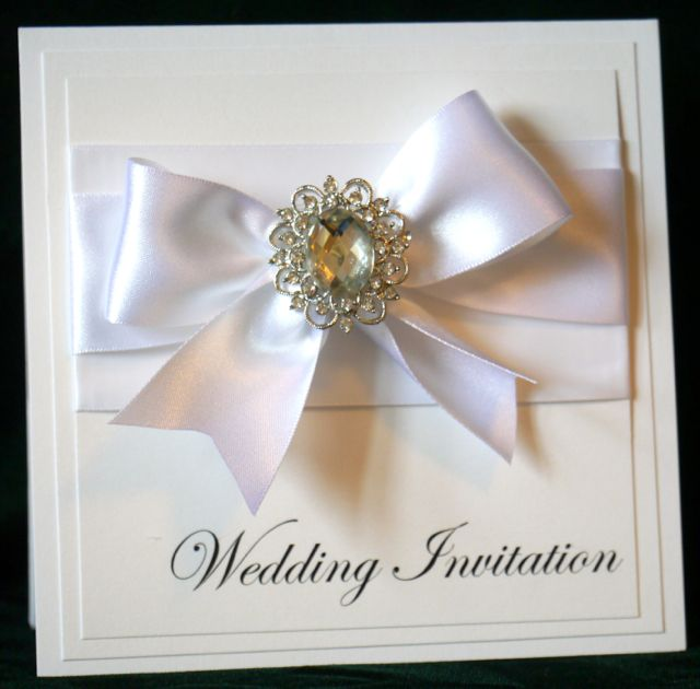 Luxury handmade wedding invitations and stationery by Peachy Impressions.