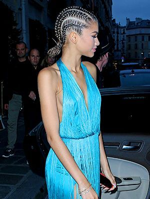 zendaya at the Buro 24/7 Family Presentation sporting cornrows pulled back into a low bun | allure.com