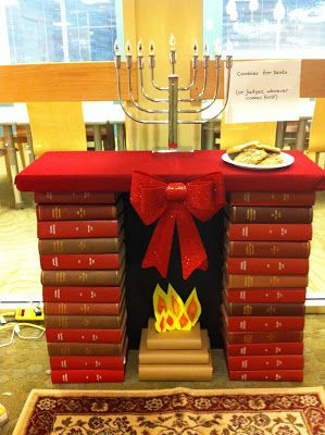Fireplace made out of books: great for makebelieve with kids or a play or even an altar for a wedding.