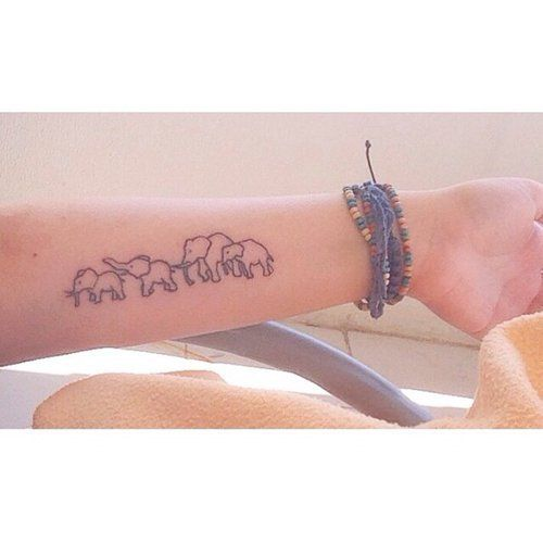 Cute small elephant family tattoo on inner arm body art for Elephant tattoo meaning family