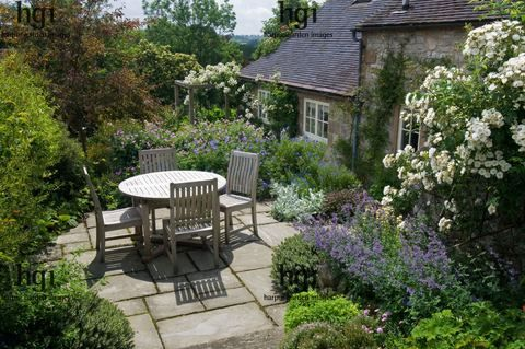 Small country patio area complementing the adjacent country style cottage