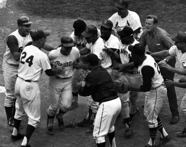 In 1964, the 35th annual Midsummer Classic shook Shea Stadium as some of the biggest names in baseball went head-to-head in a game that ended in dramatic fashion. The Phillies' Johnny Callison hit a three-run homer off Boston's Dick Radatz at the bottom of the ninth, giving the National League a 7-4 victory. Here, NL players cheer after Callison scores the game-winning run. As the MLB All-Star Game returns to the Big Apple, relive all the action from the 1964 showdown ...
