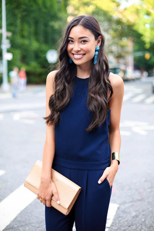 Navy jumpsuit + turquoise earrings.