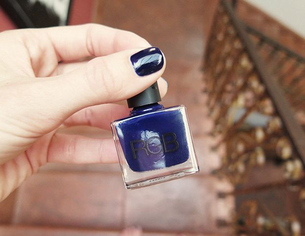 Navy blue nail polish.
