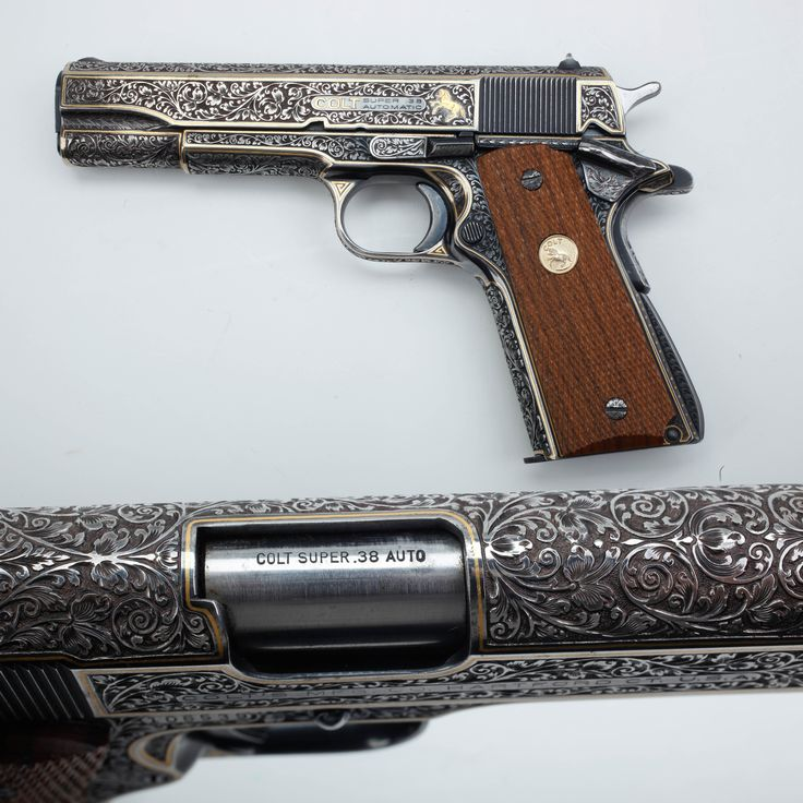 Colt .38 Super - Full coverage engraving is definitely in play for this Colt handgun, with elegant small floral scroll outlined by gold inlay work. 1929 was the year Colt introduced the updated version of the .38 Auto., originally calling this semi-rimmed round the .38 Super Auto. In addition to Colt semi-autos including the Government Model and the Commander/Combat Commander, the Thompson submachine gun was also chambered for the .38 Super round. NRA National Firearms Museum in Fairfax, VA