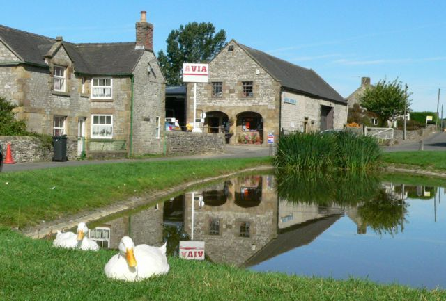 Hartington, Derbyshire,  Duck pond and cheeshop. Stood in this pond on an all night treasure hunt - yes, really !