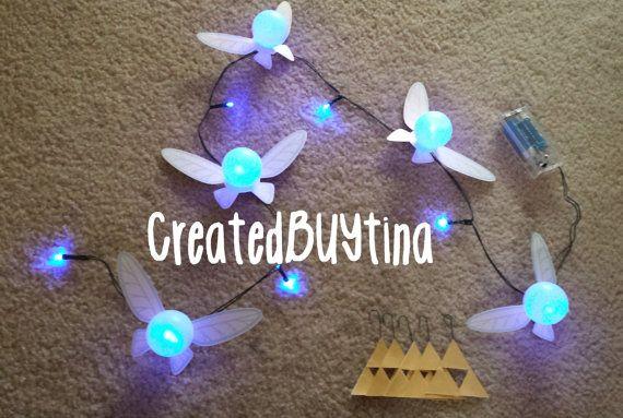 Legend of Zelda Fairy String Light blue with *BONUS* triforce, rupee, tears of light and Hylian Shield decoration    10 blue LED bulbs 5 Fairies
