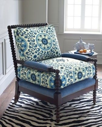 Is the suzani spindle chair (shown in blue fabric) available in the orange fabric that is shown in the Suzanni chair?