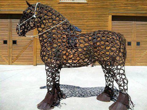 Horseshoe draft horse sculpture
