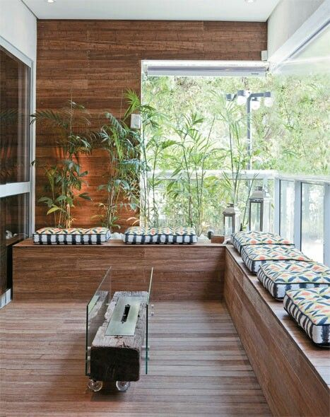 Summer style!! Balcony with wood floor and wood bench seating and a modern firepit!! Wonderful!