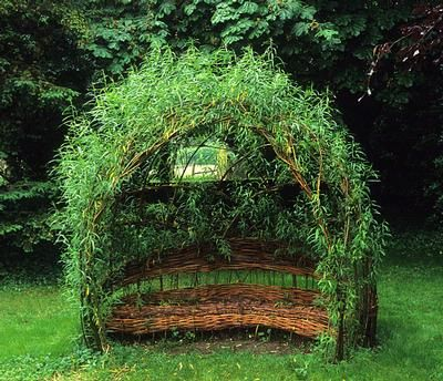 Woven living willow seat in Upton Grey Garden, Hampshire, England.
