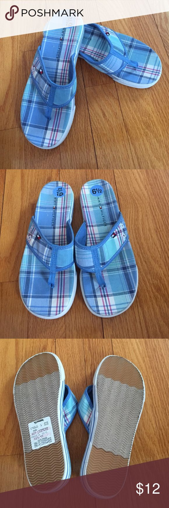 NWT TOMMY HILFIGER flip flops NWT TOMMY HILFIGER flip flops! Great shoe, has a sneaker like base for easy walking! Size 6.5. Smoke free pet free home. Will accept other offers! Tommy Hilfiger Shoes Sandals