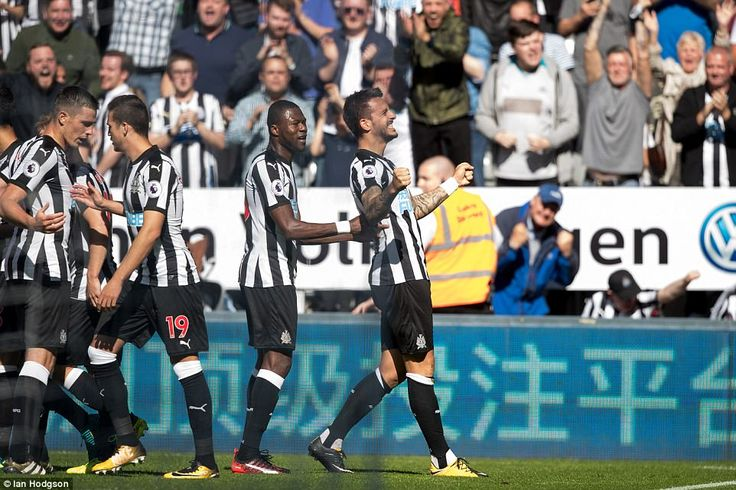 Joselu celebrates with his team mates and takes the adulation of the fans after giving them a much needed boost