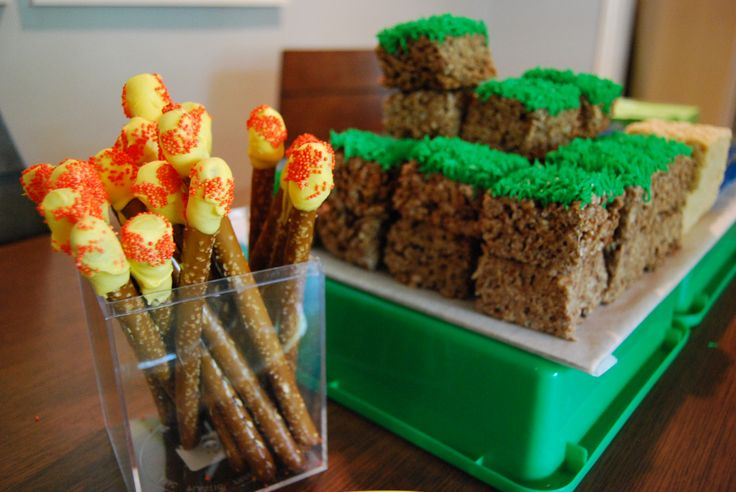 Minecraft Party  - Edible torches made from large pretzel sticks dipped in yellow melting candy and rolled in orange sprinkles.