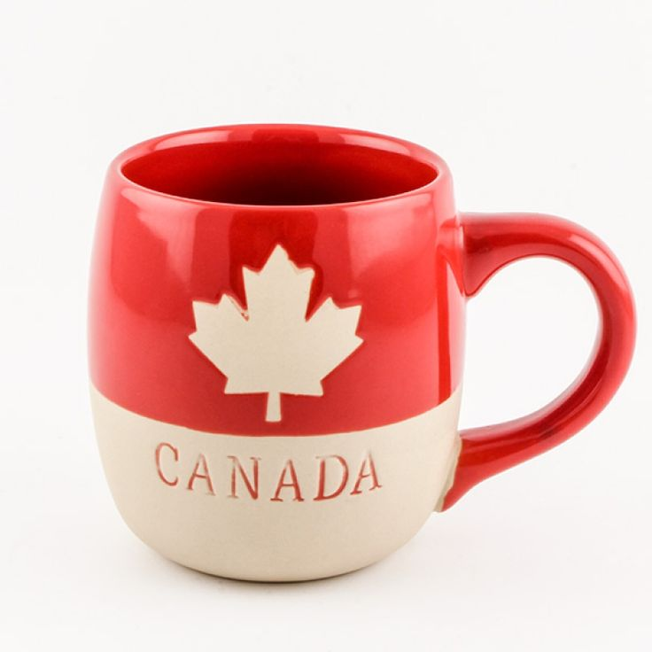 Ceramic Red Canada Mug - Drinking your morning coffee out of this mug will be a treat! This large red ceramic mug has a wide handle and is decorated with a maple leaf and CANADA to make it a great souvenir or mug for anyone.