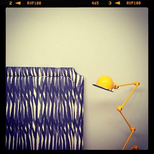 Arent - Christopher Farr Fabric on bed head & jielde bedside lamp.