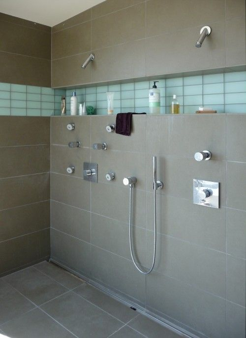 Full shower shelf under the shower heads - Great placement
