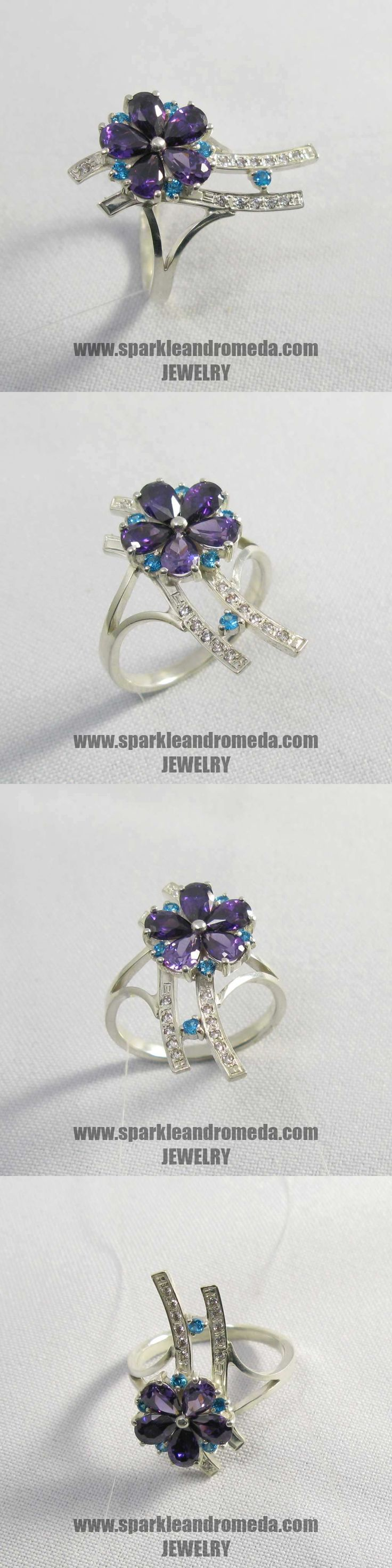 Sterling 925 silver ring with 5 pear 6×4 mm violet amethyst color 6 round 2 mm blue zircon color and 12 round 1,25 mm white color cubic zirconia gemstones.