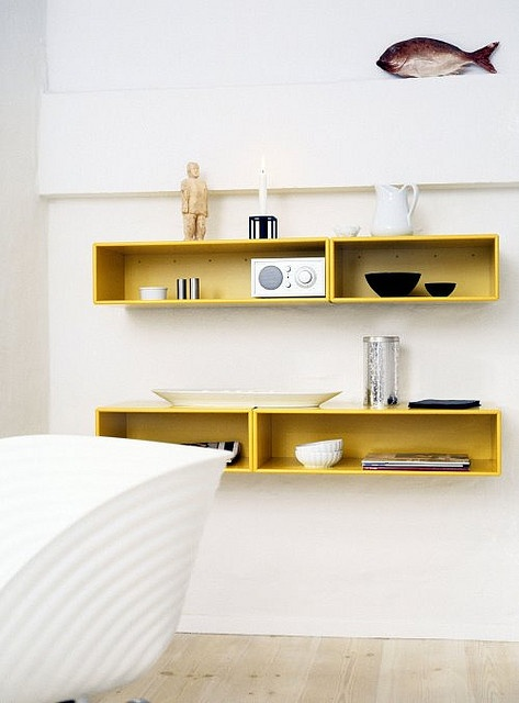 white walls & yellow box shelves Love the yellow on white. must remember this.