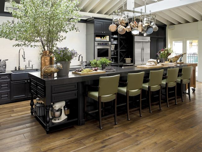 Built for entertaining. Classic and chic black cabinetry looks stunning in this chef inspired kitchen. Complete with an island that is made to host friends, when you love to cook its important to have a space that not only functions well but that looks and feels like an environment fit for your inner chef. Using a pot rack overhead is perfect to free up cabinet space and showcase your well-loved copper and stainless steel pots overhead. Proper organization is important and easy access to…