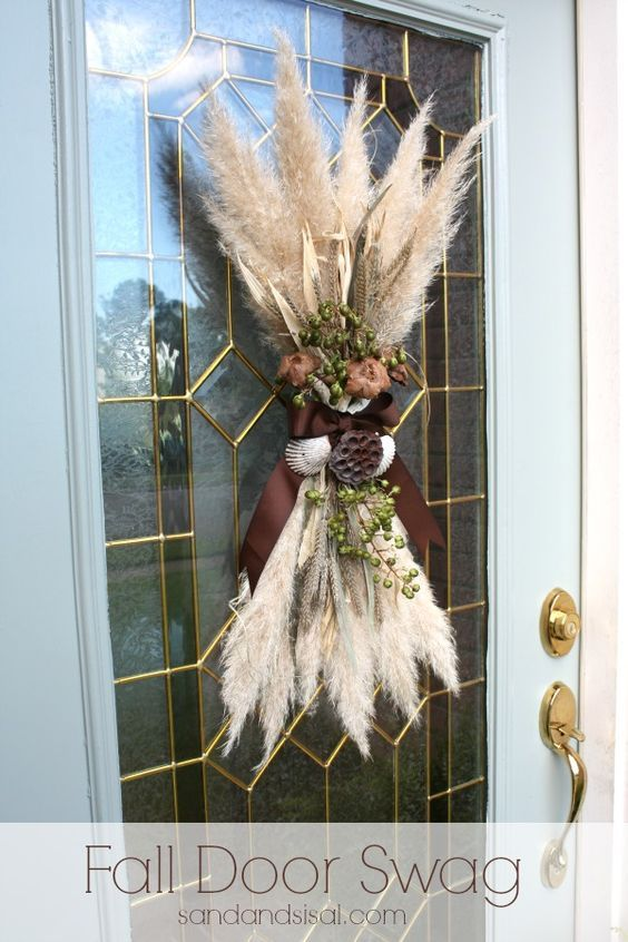 Fall Door Swag. Made from pampas grass fronds and given a coastal vibe with a few shells. DIY tutorial on how to make it from Sand & Sisal.: