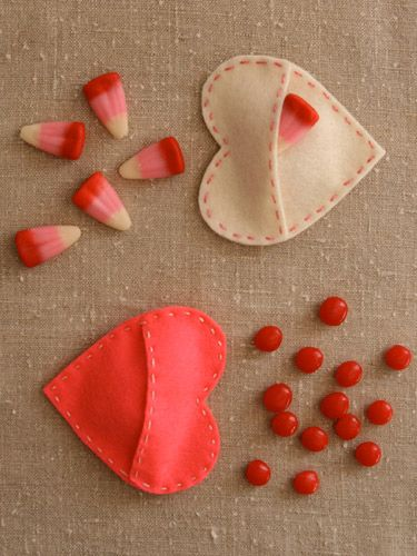 These easy-to-make, colorful felt pouches are a sweet way to give cinnamon hearts or red, pink, and white candy corn. #valentinesday #crafts #diy