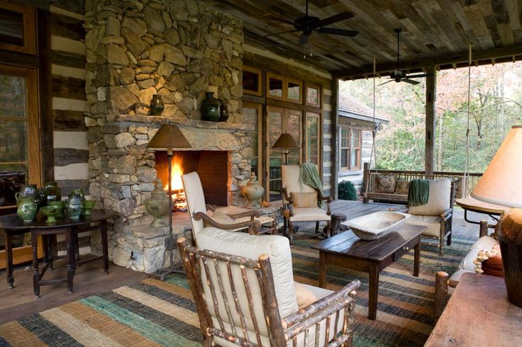 Rich wood textures and a cozy stone fireplace make this outdoor living room the ultimate mountain escape. For a custom fireplace design use materials significant to your area, like river rock for a cabin in the woods or shells for a beachy cottage. Photography by beall + thomas