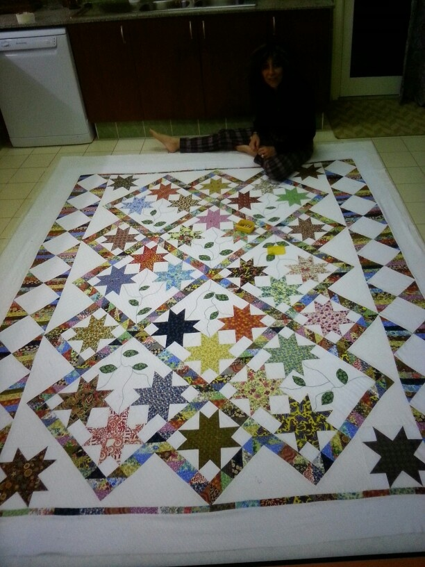 Stars quilt being layered