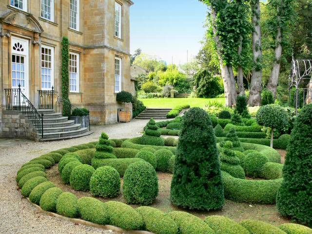 garden design with bourton house garden parterre with wine barrel planter from placestogo org uk