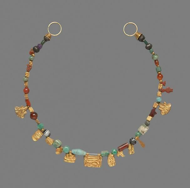 Ancient Egyptian necklace dated to the New Kingdom, or 1500-1200 BCE. It appears to be made of gold, turquoise, carnelian, banded agate, and amethyst. Found in the Kunsthistorisches Museum.