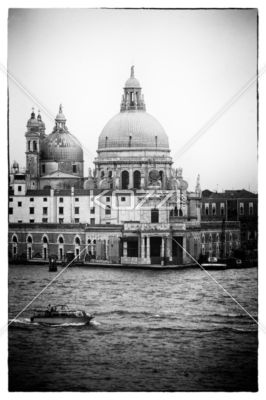 black and white image of a dome in venice, italy - Black and white image of a old fashioned building by sea in Venice.