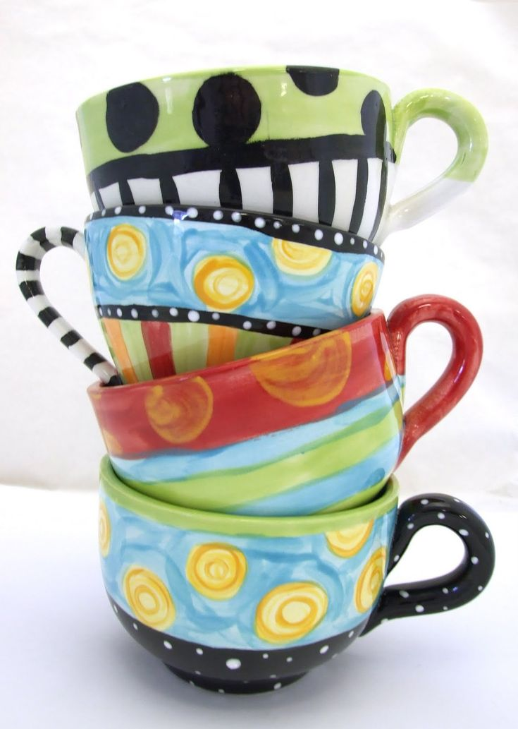 Mugs - I like the idea of hanging interesting mugs from the hanging pot rack - I don't have any quite as nice / artsy as these but I could build a collection - and I certainly have some colourful ones!