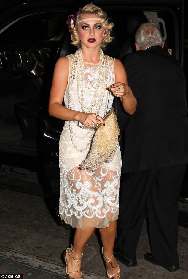 Top-to-toe look: Julianne took the time to accessorise her flapper dress outfit with a fan, necklace and headband at her birthday celebrations