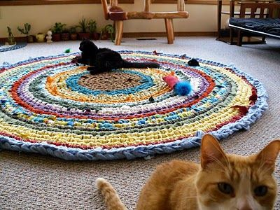 Crocheted rag rugs ... I want to learn how to do this. She makes them sound so easy! Easier than the instructions I've seen for braided (and sewn) rugs. Gonna have to tear some old sheets into strips and try this!