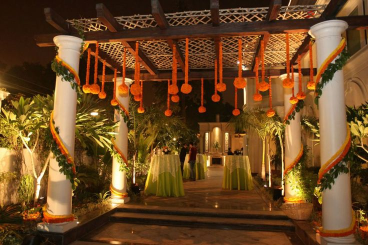Home Decoration In Punjabi Wedding : Traditional floral decoration at the entrance indian