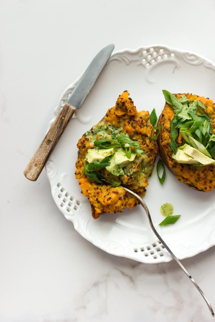 Vegan stuffed sweet potatoes with coconut curried quinoa, chickpeas and avocado cilantro sauce