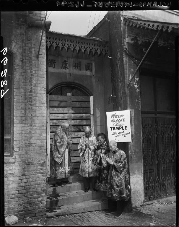 Chinatown residents pray to save Old Chinatown Buddist Temple, Los Angeles (Calif.) Prayers offered--These elderly Chinese men pray in front of boarded-up entrance of the Buddhist Temple off Ferguson Alley, adjoining the Plaza, in the hope of saving it from demolition by the city. Chinese are taking lead in preservation drive Creator/Contributor: Los Angeles Times (Firm), Publisher Date: September 14, 1950